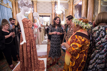 Catherine, Duchess of Cambridge talks to Tukua Turia from The Cook Islands at a reception to celebrate the Commonwealth Fashion Exchange at Buckingham Palace in London