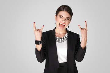 Rock and roll! Businesswoman showing rock sign