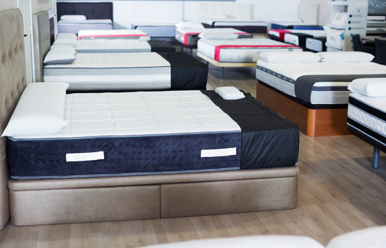 new mattresses on the beds in the store