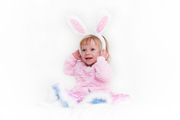 Closeup Portrait of Blonde Baby 18 month old Girl with Big Blue Eyes and  Bunny Ears headband, Pink Tutu, isolated on white background.