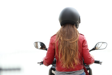 Back view of a motorbiker on a motorcycle on white
