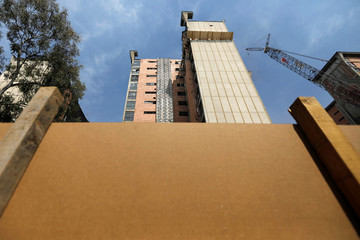 A building being demolished is pictured five months after the September 19 earthquake, in the Colonia Doctores neighborhood in Mexico City