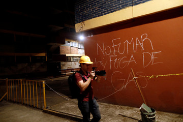 """Graffiti reading """"No smoking, there is a gas leak"""" is seen in the Tlalpan housing project five months after the September 19 earthquake, in the Educacion neighborhood in Mexico City"""