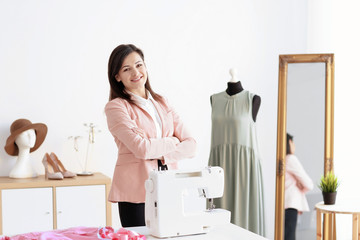 Portrait of young woman in atelier. Small business owner