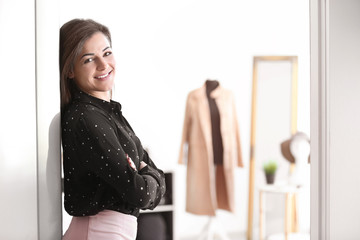 Portrait of young woman in boutique. Small business owner