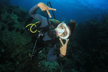 Scuba dive. Young Asian woman scuba diving