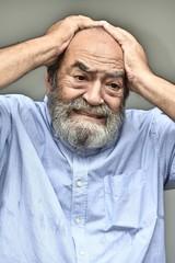 Senior Colombian Grandpa Under Stress