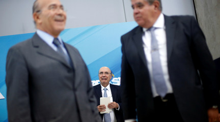 Brazil's Finance Minister Henrique Meirelles reacts after attending a news conference in Brasilia
