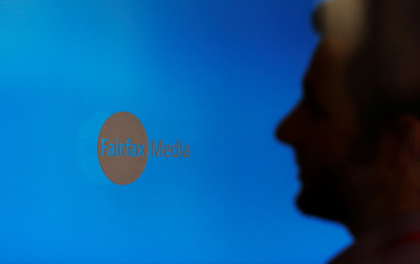 A man sits in the lobby of the Fairfax Media building in Sydney