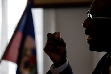 Haiti's Minister of Planning and External Cooperation Aviol Fleurant speaks during an interview with Reuters in Port-au-Prince