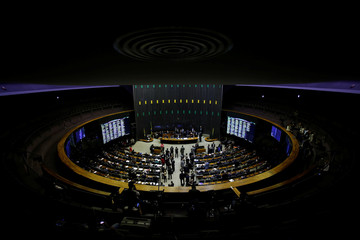 Members of the lower chamber of Brazil's Congress attend a session to vote on the decree of the army to take over command of police forces in Rio de Janeiro state, at Brazilian national Congress in Brasilia