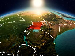 Uganda in sunrise from orbit Wall mural