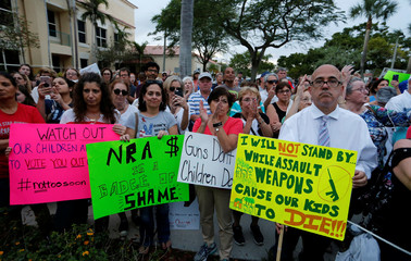 Protesters take part in a Call To Action Against Gun Violence rally by the Interfaith Justice League and others in Delray Beach, Florida