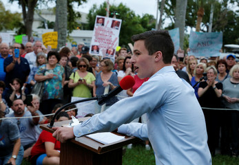 Cameron Kasky, a student at Marjory Stoneman Douglas High School, speaks to protesters at a Call To Action Against Gun Violence rally by the Interfaith Justice League and others in Delray Beach