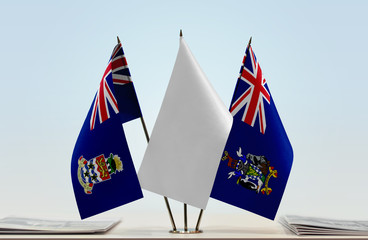 Flags of Cayman Islands and South Georgia and Sandwich with a white flag in the middle