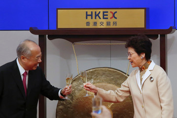 Hong Kong Chief Executive Carrie Lam and Hong Kong Exchanges and Clearing Limited Chairman Chow Chung-kong toast during the first trading day in the Year of the Dog at Hong Kong Exchanges in Hong Kong