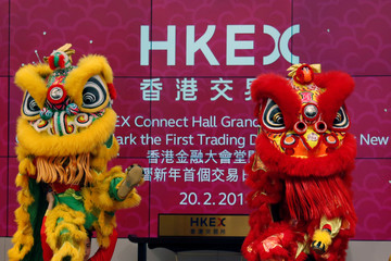 A lion dance is performed during the first trading day in the Year of the Dog at Hong Kong Exchanges in Hong Kong