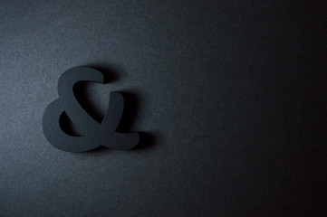 black bold ampersand on black background