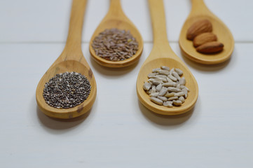 four wooden spoons with seeds close up