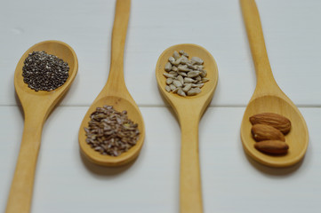 four wooden spoons with seeds perspective view