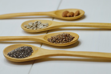 four wooden spoons with seeds side view