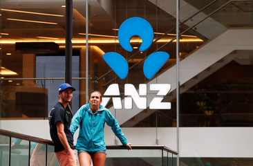 A couple talk in front of an ANZ bank branch in central Sydney
