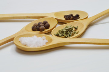 spoons arrangement with spices close up