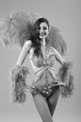 Young dancer in bikini and suit with feathers