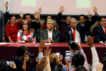 Andres Manuel Lopez Obrador, presidential candidate of the National Regeneration Movement (MORENA) looks on as he is sworn in as presidential candidate of Partido del Trabajo (Labor Party), in Mexico City
