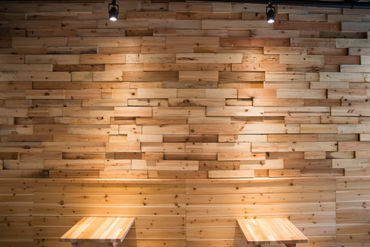 Planks brown wooden panel wall with two dimming downlight lights