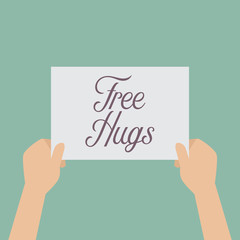 Hands holding a Free hugs sign