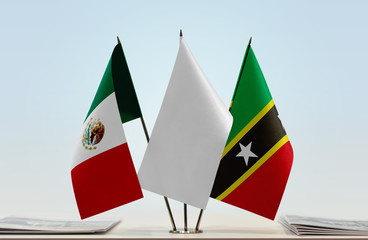 Flags of Mexico and Saint Kitts and Nevis with a white flag in the middle
