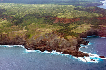 Aerial view of the coast of the island of Maui in Hawaii, shot from a small, low-flying prop plane