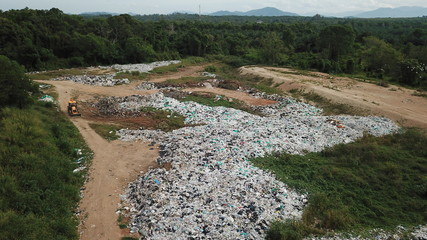 Plastic pollution - landfill garbage dump. Plastic bags and bottles pollute the environment