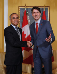 Canadian Prime Minister Justin Trudeau shakes hand with Infosys Chief Executive Officer Salil Parekh during a meeting in Mumbai