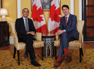 Canadian Prime Minister Justin Trudeau and Infosys Chief Executive Officer Salil Parekh attend a meeting in Mumbai