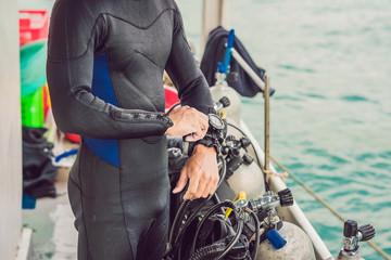 Diver preparing to dive into the sea