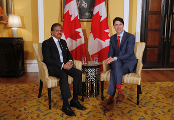 Canadian Prime Minister Justin Trudeau attends a meeting with Anand Mahindra, Chairman of Mahindra Group in Mumbai