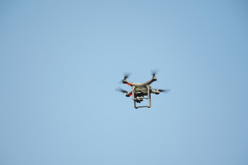 Surveillance drone flying on sky i
