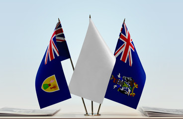 Flags of Turks and Caicos Islands and South Georgia and Sandwich with a white flag in the middle
