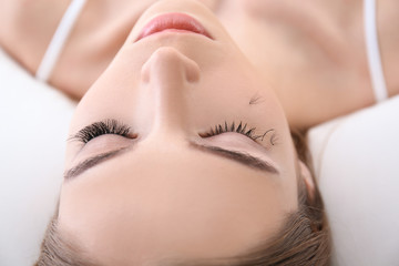 Young woman with eyelash loss problem, closeup