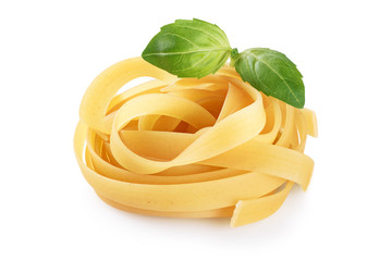 Raw tagliatelle pasta and basil isolated on white background.