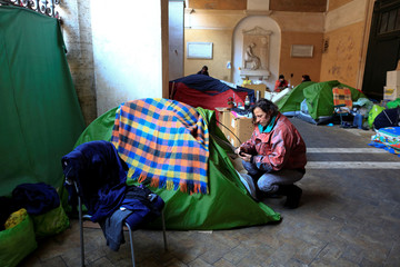 Angela Grossi is seen next to her tent in the portico of the Basilica of the Santi Apostoli where she lives in Rome