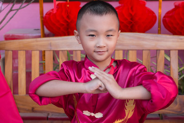 Asian boy  in red Chinese dress during Chinese New Year Celebration