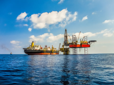 Offshore facility in oil industry construction, there are drilling rig, platform and FPSO tanker ship.