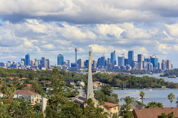 A view of Watsons Bay and the distant skycrapers of Sydney' CBD, Water with Yacht, Harbour Bridge and Cityscape in background
