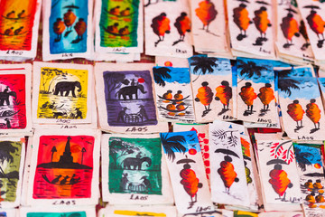 Souvenir pictures in the local market, Luang Prabang, Laos. Close-up.