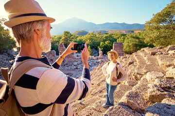 Travel and tourism. Senior family couple taking photo together on ancient sightseeing.