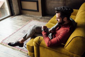stylish elegant man looking at watch