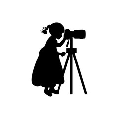 Silhouette girl photographer looking camera